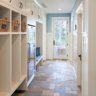 Beach style hallway in Grand Rapids with blue walls, slate floors and multi-coloured floor.