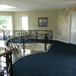 Hallway - mid-sized traditional carpeted and blue floor hallway idea in Other with beige walls