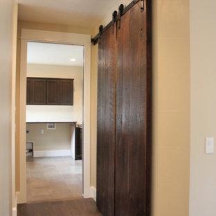 Example of a mid-sized danish dark wood floor and brown floor hallway design in Other with beige walls