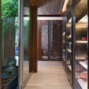 Hallway - contemporary light wood floor and beige floor hallway idea in Seattle