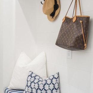 На фото: коридор среднего размера в морском стиле с белыми стенами, паркетным полом среднего тона и коричневым полом с