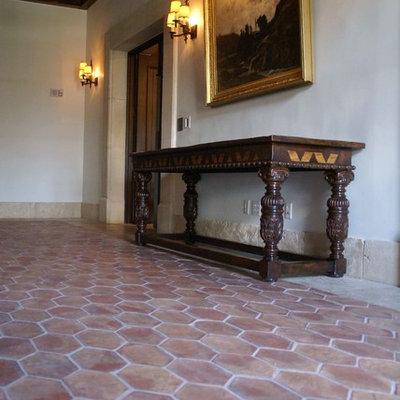 Inspiration for a timeless terra-cotta tile hallway remodel in Barcelona
