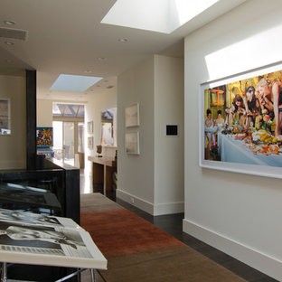 Inspiration for a large contemporary dark wood floor and brown floor hallway remodel in San Francisco with white walls