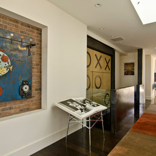 Large trendy dark wood floor and brown floor hallway photo in San Francisco with white walls