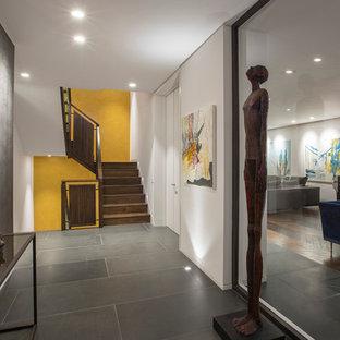 Trendy gray floor hallway photo in London