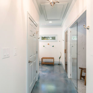 Small beach style hallway in Atlanta with white walls, concrete floors and blue floor.
