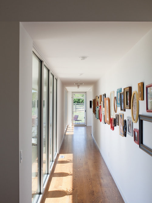 Long hallway houzz for How to decorate a hallway