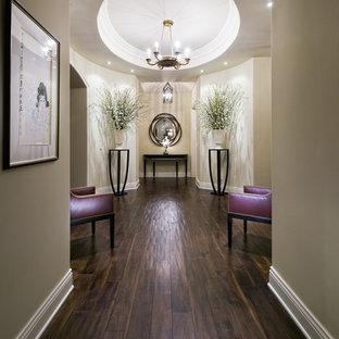 Example of a trendy dark wood floor and brown floor hallway design in Los Angeles with beige walls