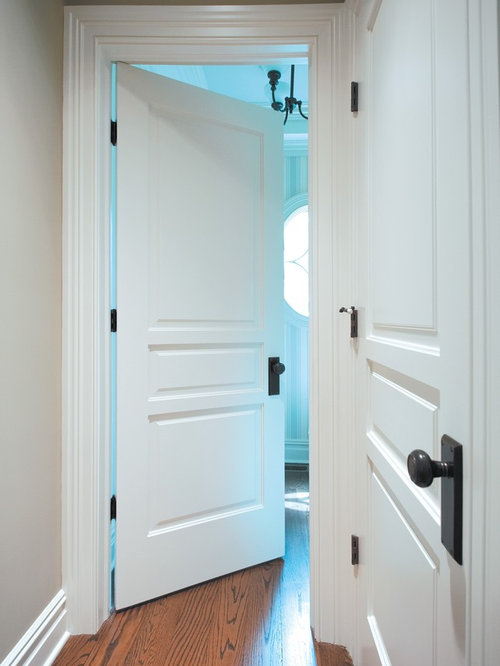 Example of a mid-sized classic medium tone wood floor and brown floor  hallway design - Oil Rubbed Bronze Door Hardware Houzz