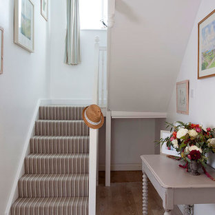 Inspiration for a small beach style hallway in Cornwall with white walls and medium hardwood floors.