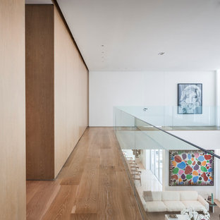 Inspiration for a contemporary medium tone wood floor and brown floor hallway remodel in Miami with white walls