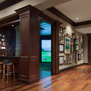 Inspiration for a huge timeless dark wood floor hallway remodel in Tampa with beige walls