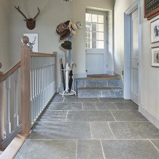 Hallway - traditional limestone floor hallway idea in Wiltshire