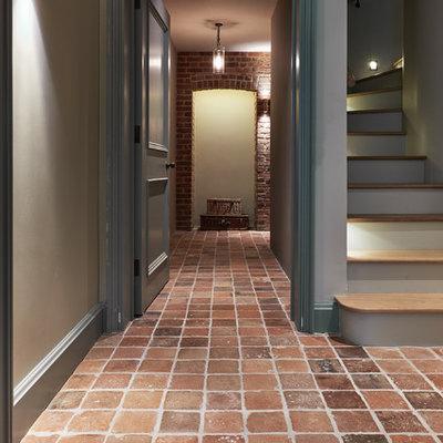Example of a classic terra-cotta tile hallway design in Wiltshire