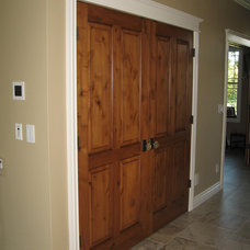 Traditional Hall by Custom Millwork & Finishing