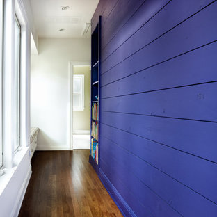 Inspiration for a contemporary medium tone wood floor hallway remodel in Austin with purple walls