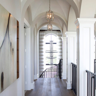 Mid-sized elegant dark wood floor hallway photo in Miami with white walls