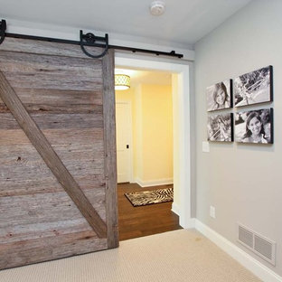 Hallway - rustic carpeted hallway idea in Minneapolis with gray walls