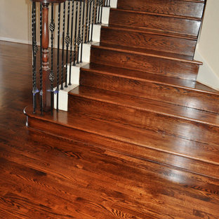 Example of a mid-sized classic dark wood floor and brown floor hallway design in Dallas with beige walls