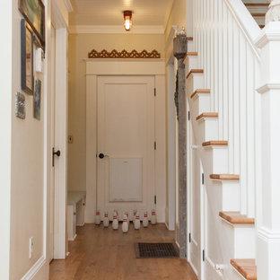 Eclectic medium tone wood floor hallway photo in Portland with beige walls