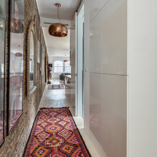 Inspiration for a contemporary white floor hallway remodel in London with white walls