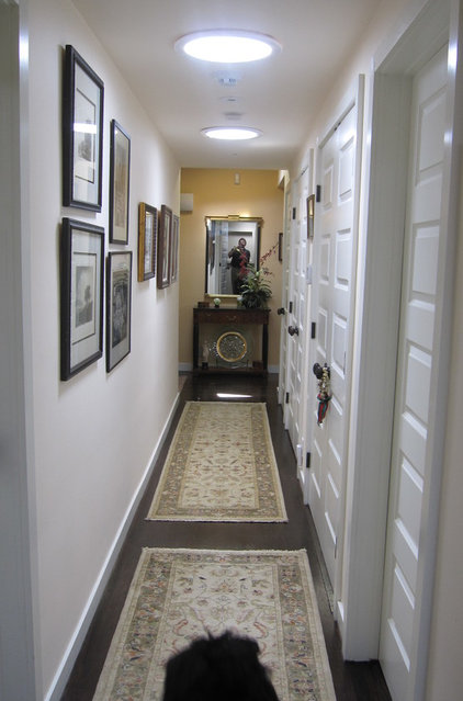 Contemporary Hall by Addition Building & Design, Inc.