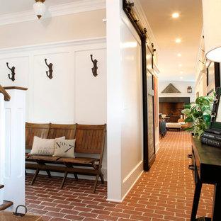 На фото: коридор в классическом стиле с кирпичным полом и красным полом с