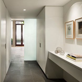 Inspiration for a modern gray floor hallway remodel in San Francisco with white walls