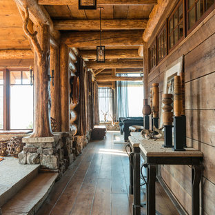 Inspiration for a rustic dark wood floor hallway remodel in Other