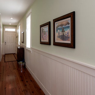 Design ideas for a mid-sized beach style hallway in Miami with green walls and medium hardwood floors.
