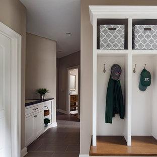 Hallway - small craftsman porcelain floor and gray floor hallway idea in Milwaukee with gray walls