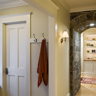 Elegant medium tone wood floor and beige floor hallway photo in Burlington with beige walls