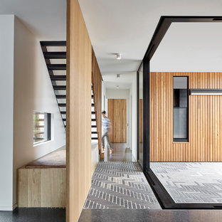 Design ideas for a contemporary hallway in Melbourne with concrete floors and black floor.