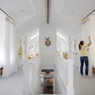 Inspiration for a mid-sized beach style hallway remodel in Atlanta with white walls