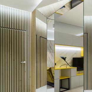 Пример оригинального дизайна интерьера: коридор в современном стиле с белым полом