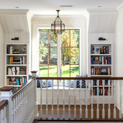 Large cottage medium tone wood floor and brown floor hallway photo in Other with white walls
