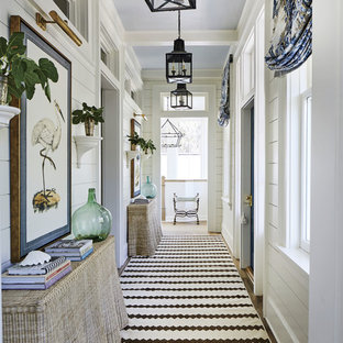 Design ideas for a beach style hallway in Jacksonville with white walls.