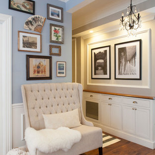Hallway - small shabby-chic style medium tone wood floor and brown floor hallway idea in New York with blue walls