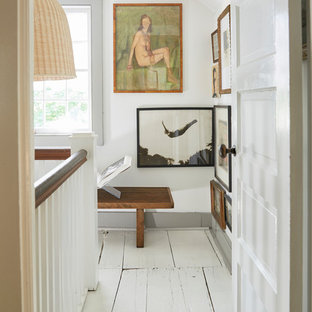 Example of a cottage painted wood floor and white floor hallway design in New York with white walls