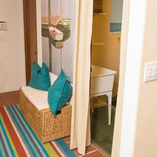 This is an example of a mid-sized beach style hallway in Other with white walls, terra-cotta floors and red floor.