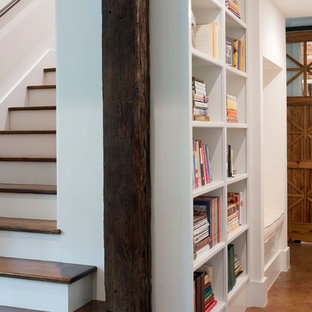 Photo of a mid-sized beach style hallway in Charleston with white walls and concrete floors.