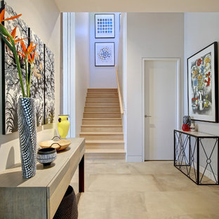 Inspiration for a large contemporary hallway in Adelaide with white walls, grey floor and porcelain floors.
