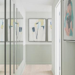 Mid-sized mid-century modern light wood floor and beige floor hallway photo in New York with green walls