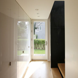 Stair Hall with White Acrylic Cabinets and Black Steel
