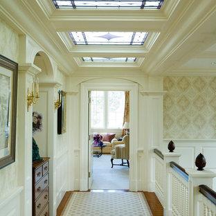 Ornate medium tone wood floor hallway photo in Boston with white walls