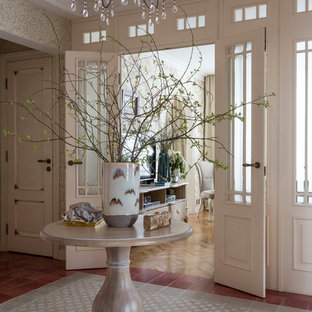 Design ideas for a mid-sized traditional hallway in Moscow with beige walls, ceramic floors and beige floor.