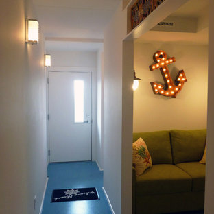 Inspiration for a small beach style hallway in Other with white walls and linoleum floors.