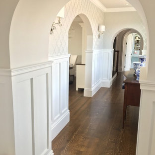 Inspiration for a large beach style hallway in Providence with white walls and dark hardwood floors.