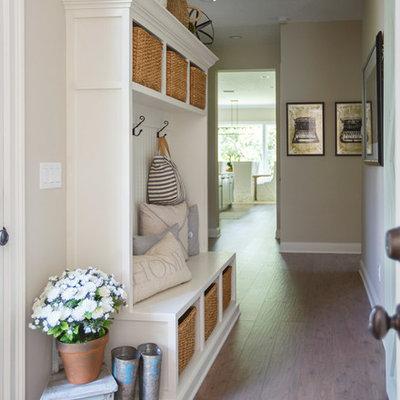 Hallway - mid-sized traditional medium tone wood floor and brown floor hallway idea in Jacksonville with beige walls
