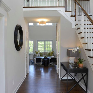 Example of a small cottage chic medium tone wood floor hallway design in New York with white walls
